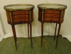 A pair of French style kidney shaped side tables, with brass galleries and mounts, three drawers
