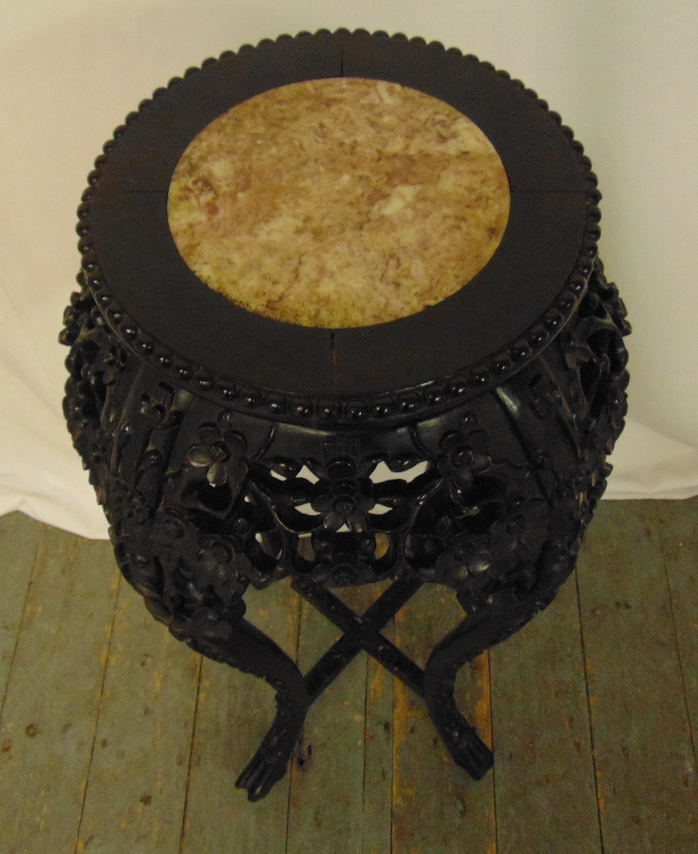 A Chinese hardwood plant stand with inlaid marble top, pierced and profusely carved with prunus - Image 2 of 2