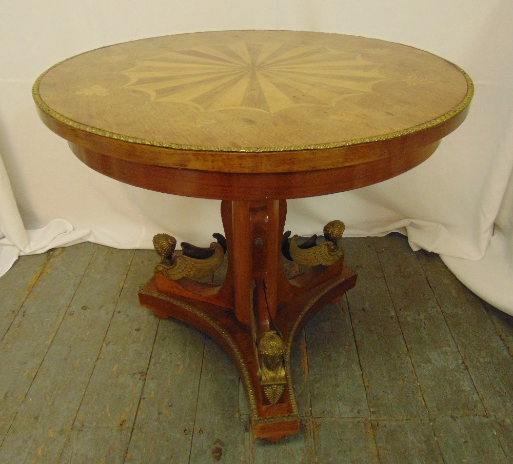 A continental circular occasional table on pedestal base with applied gilded cast metal harpies