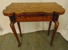 A Victorian mahogany and inlaid satinwood games table with hinged top on four cabriole legs, 77 x