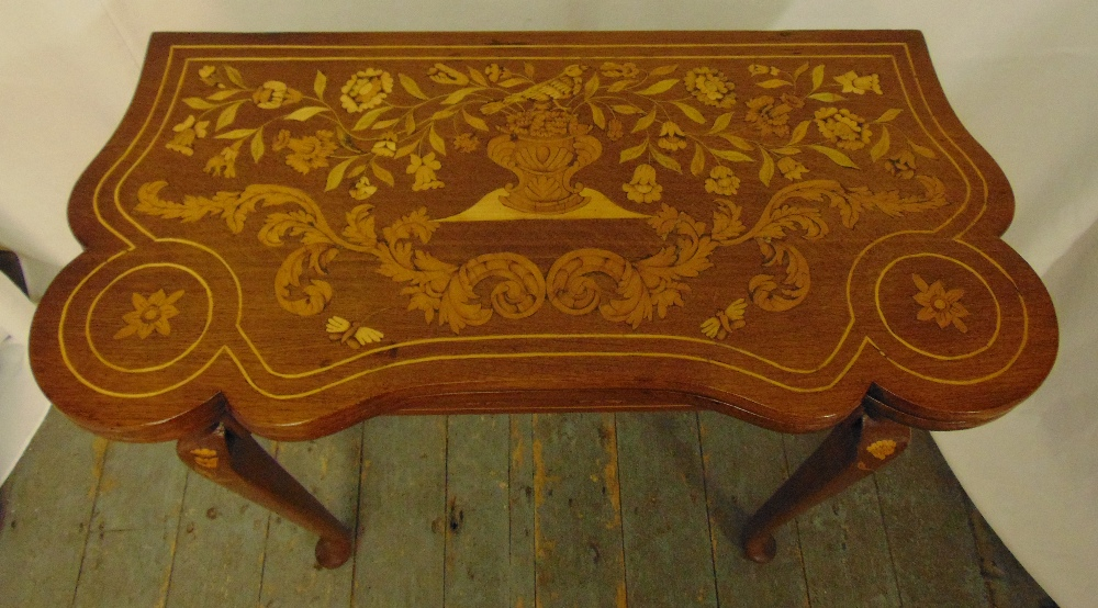A Victorian mahogany and inlaid satinwood games table with hinged top on four cabriole legs, 77 x - Image 2 of 3