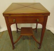A mahogany envelope card table, the single drawer with brass handles on four tapering rectangular