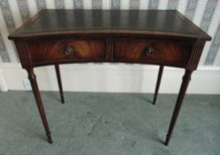 A rectangular mahogany desk with two drawers, tooled leather top on tapering cylindrical legs, 78