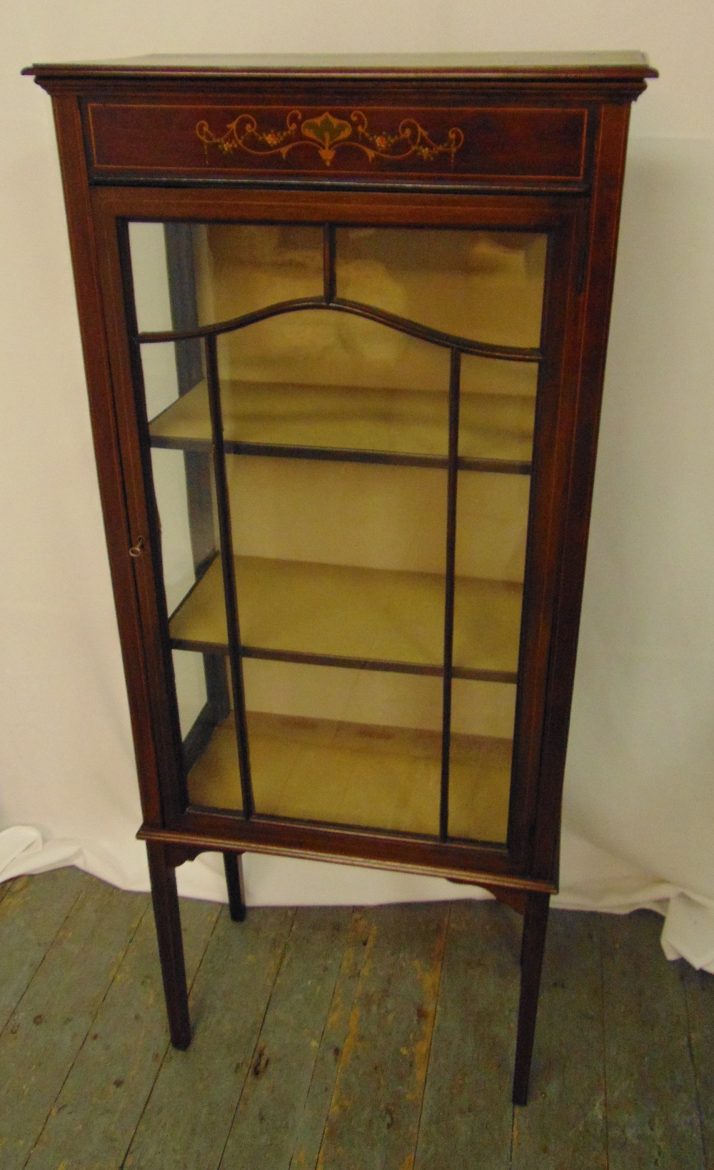 An Edwardian rectangular mahogany and inlaid satinwood glazed display cabinet on four tapering