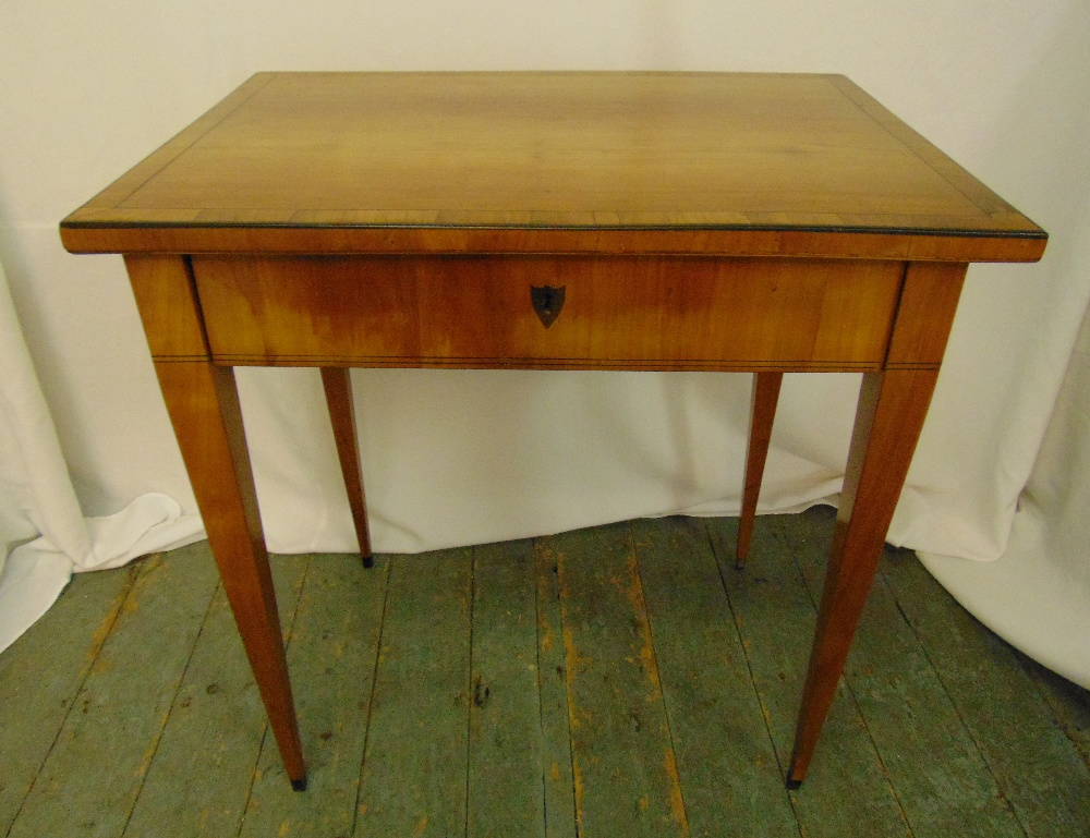 A rectangular mahogany dressing table, the hinged cover revealing compartmentalised interior all