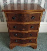 A rectangular fruit wood four drawer chest of drawers with bow front on four bracket feet, 72 x 48.5