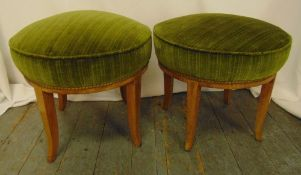 A pair of circular upholstered stools on four outswept legs, 44.5 x 50cm