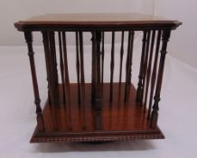 An Edwardian mahogany revolving table top bookcase, shaped square with turned columns, 34cm (h)