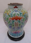 A Chinese 19th century lamp base, baluster form decorated with bats, flowers and leaves on turned