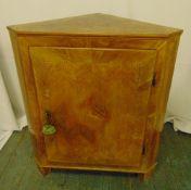 A continental inlaid fruitwood corner cabinet with hinged door on three bracket feet, 90 x 76.5 x