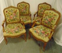 A set of four mahogany armchairs with upholstered tapestry backs and seats on cabriole legs