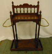 A rectangular mahogany umbrella and stick stand with brass mounts on rectangular plinth, 82.5 x 64 x