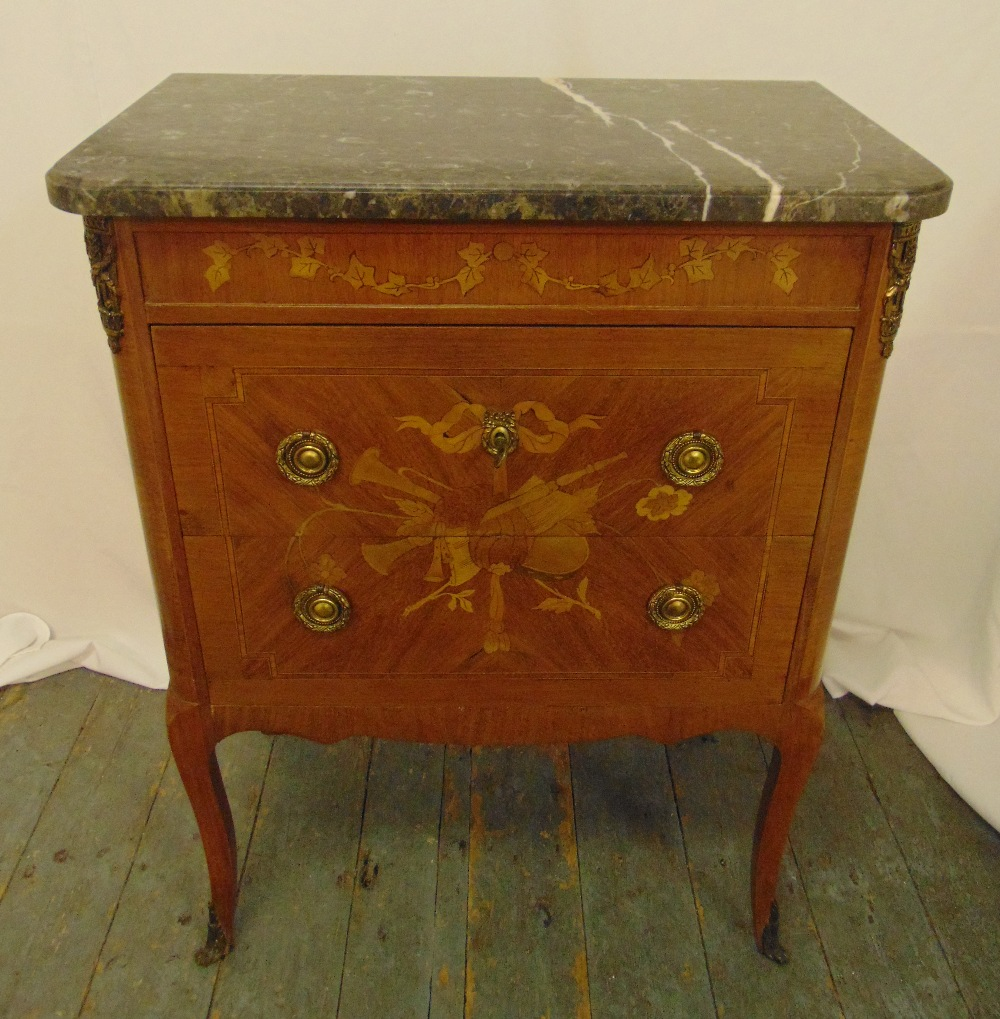 A continental rectangular mahogany inlaid chest of drawers with grey marble top on four cabriole
