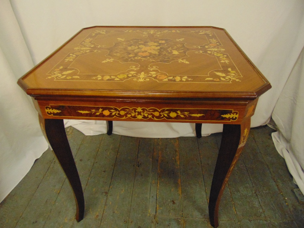 An Italian rectangular Sorrento style games table inlaid with floral clusters and stylised leaves