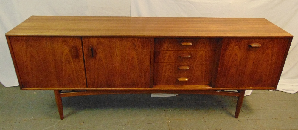 G-Plan 1970s rectangular teak sideboard with drawers and cupboards on four tapering turned supports,