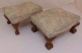 A pair of rectangular foot stools on ball and claw feet, 21 x 42 x 31cm
