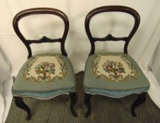 A pair of Victorian mahogany balloon back occasional chairs with tapestry seats on cabriole legs,