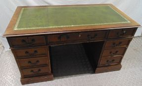 A reproduction mahogany pedestal desk with tooled leather top, brass handles, 76.5 x 137.5 x 69cm