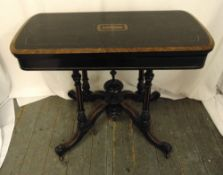 A Victorian ebonised games table on four outswept legs, 73 x 92 x 45cm