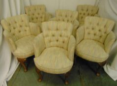A set of six upholstered occasional chairs on cabriole legs