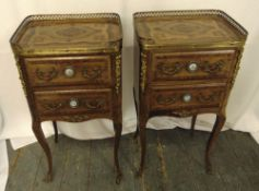 A pair of French style rectangular two drawer side tables with gilt metal handles and applied