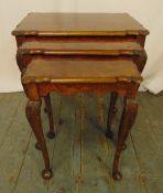 A mahogany and walnut nest of three tables on cabriole legs, 53.5 x 55.5 x 37cm