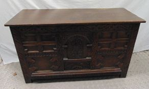 A 19th century oak blanket box the front and sides carved with flowers and scrolls, hinged cover, on