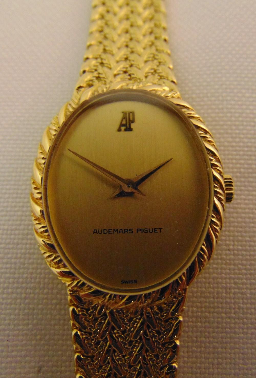 Audermars Piquet 18ct gold ladies wristwatch on integral bracelet, approx total weight 49.9g