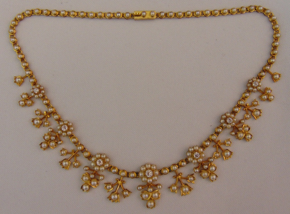 A Victorian gold, diamond and seed pearl necklace set with seven diamonds and pearl clusters with