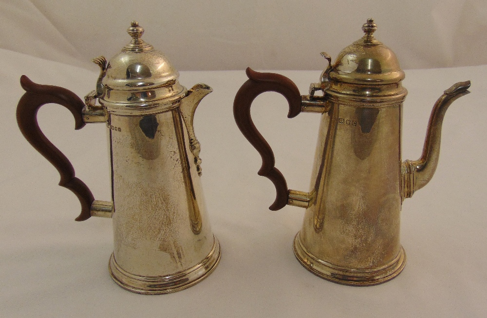A hallmarked silver coffee pot London 1938 and hot water jug London 1910, approx total weight 1098g