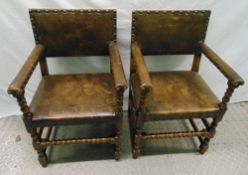A pair of 19th century oak and leather armchairs with turned legs and stretchers