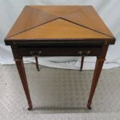 A mahogany envelope card table with single drawer on four tapering rectangular legs with original