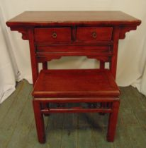 An early 20th century oriental lacquered wooden desk of rectangular form with a matching stool, desk