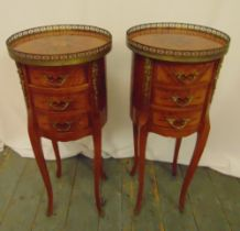 A pair of French style cylindrical three drawer side tables with pierced gallery tops on cabriole