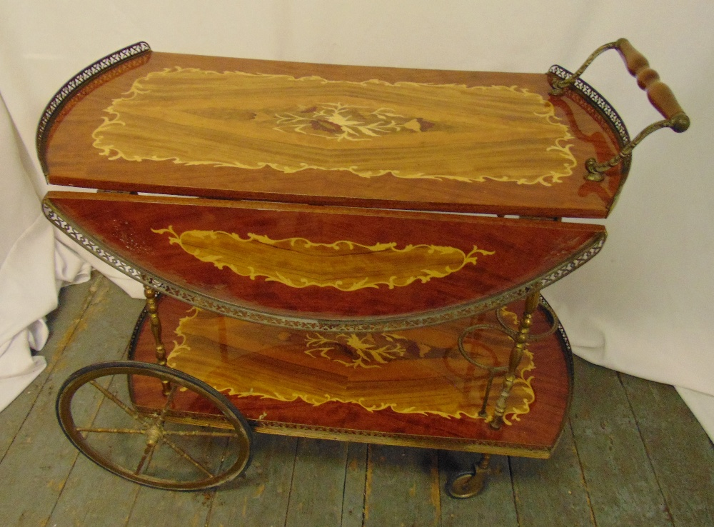A Sorrento style shaped rectangular two tier drinks trolley, turned wooden handle, hinged side