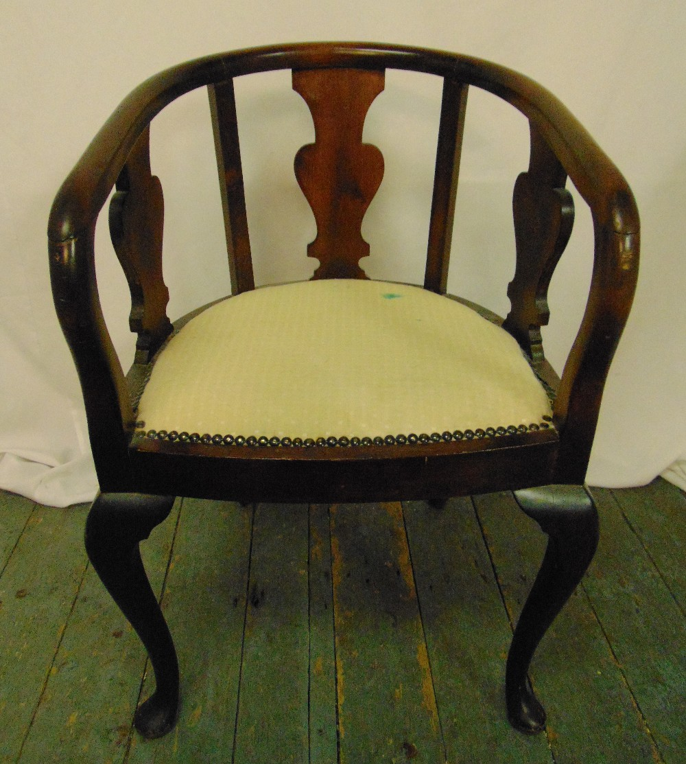 A mahogany occasional chair, pierced sides on four scroll legs, 77 x 51 x 52cm