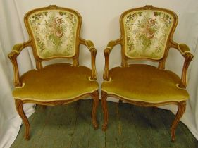 A pair of upholstered armchairs on four cabriole legs, 96 x 59 x 50cm each