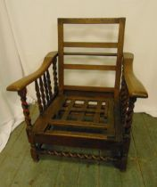 An early 20th century oak steamer chair with barley twist columns to the sides and base, 94 x 72 x