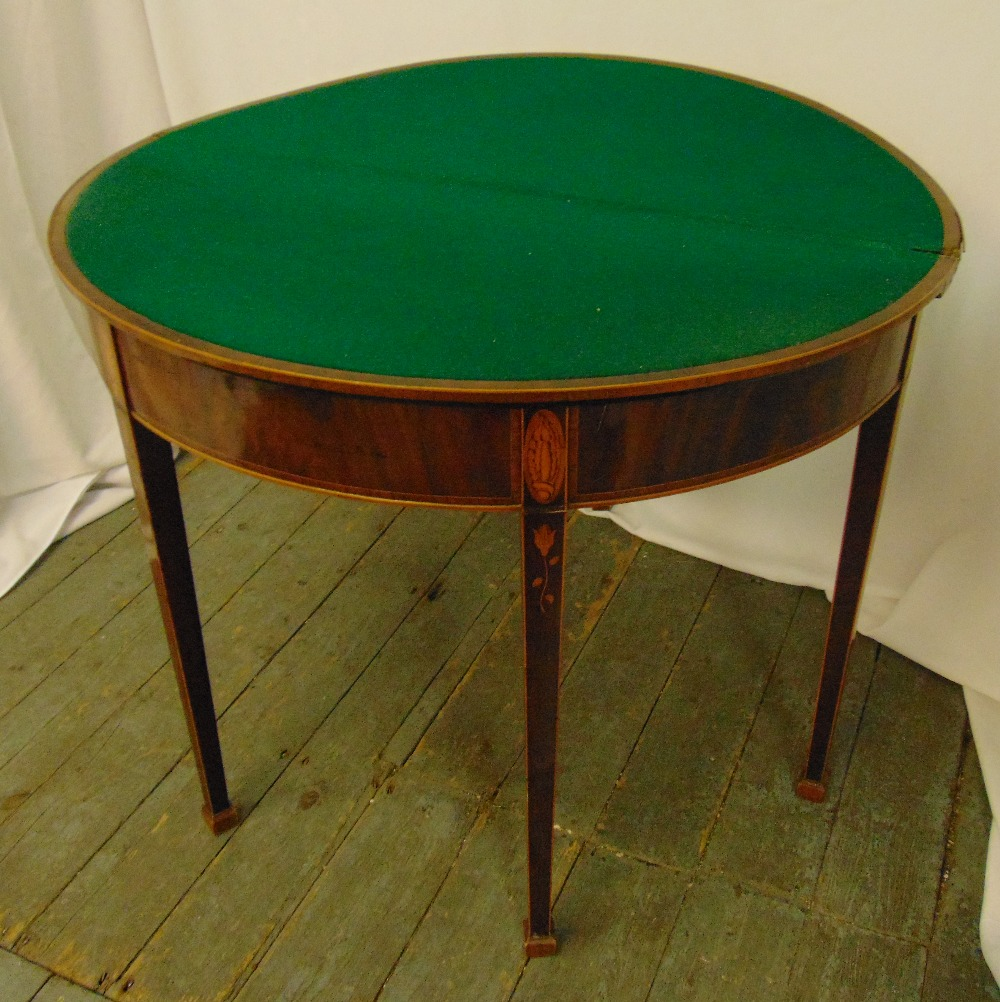 A Regency mahogany and satinwood inlaid demilune card table on four tapering rectangular legs, 74 - Image 2 of 2