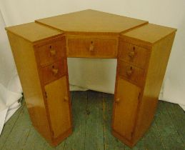 An Art Deco blonde oak corner desk with seven drawers and turned handles, 74 x 65.5 x 63cm