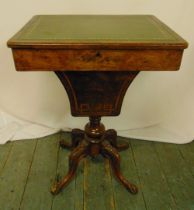 A Victorian rectangular walnut work table with hinged inset leather top on four carved scrolling