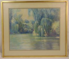 A framed and glazed pastel of a lake and trees, indistinctly signed bottom left, 54 x 65.5cm