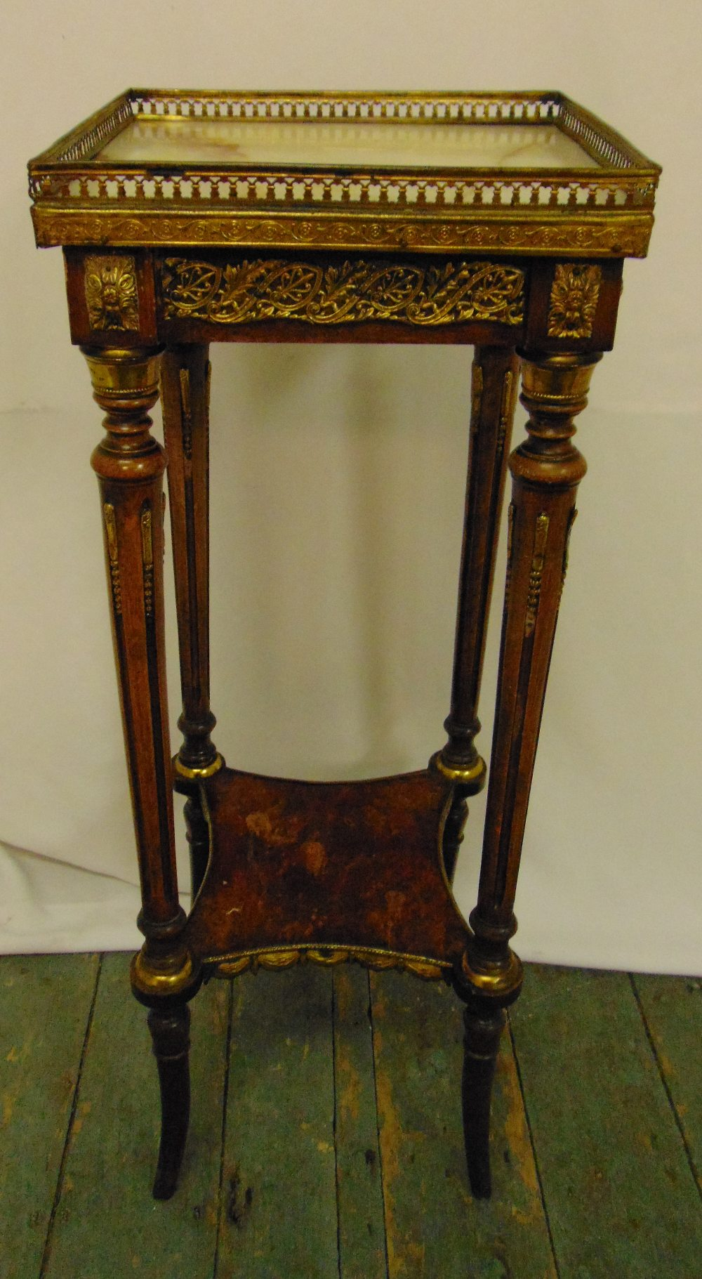 A French style rectangular plant stand with pierced gallery top on four cabriole supports, 82 x 30.5