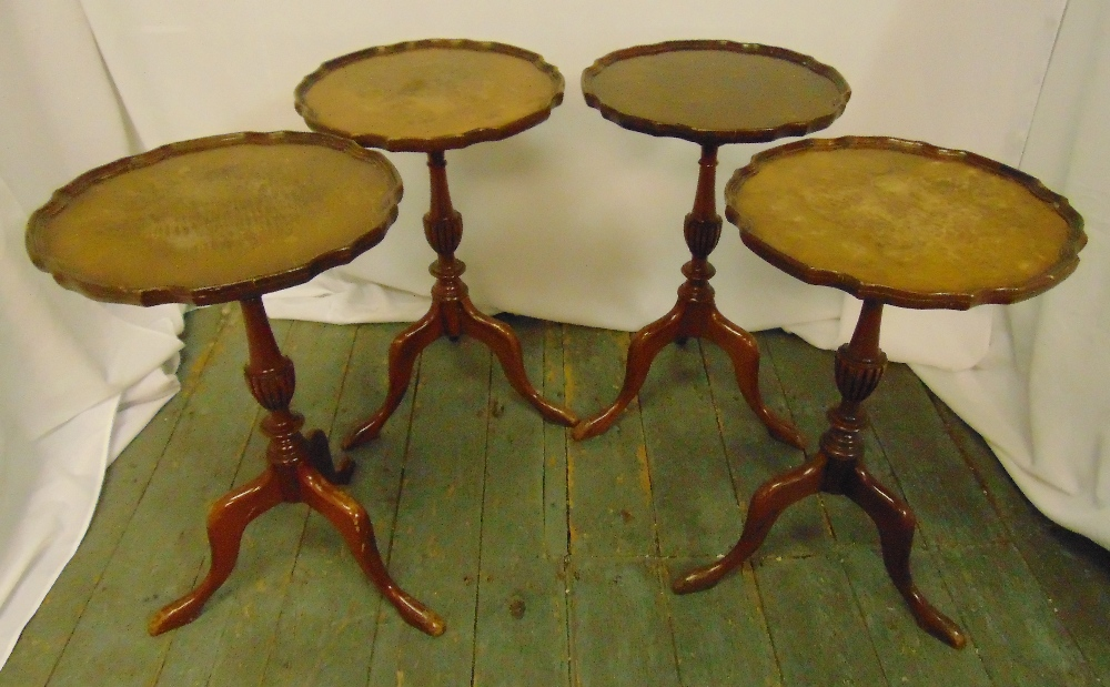 A set of four mahogany wine tables with Chippendale borders on three outswept legs, 57 x 37.5cm