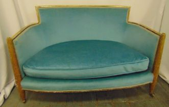 A late 19th century French upholstered settle with fluted supports on tapering legs on original