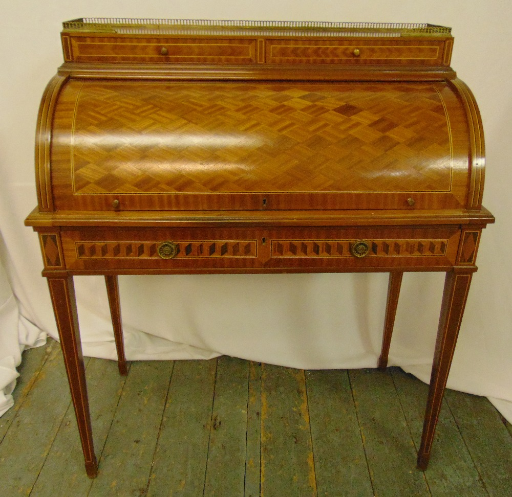 A continental roll top Kingswood and mahogany desk, the cover revealing leather mounted interior
