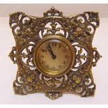 A French brass easel clock with scroll pierced frame the circular engine turned dial with Arabic