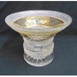 A continental faceted glass bowl of campagna form decorated with gilded flowers and scrolls on raise