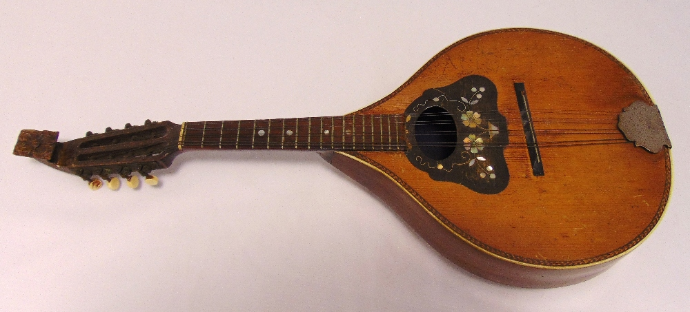 A balloon back eight string mandolin decorated with mother of pearl flowers and leaves, A/F, 64 x 27