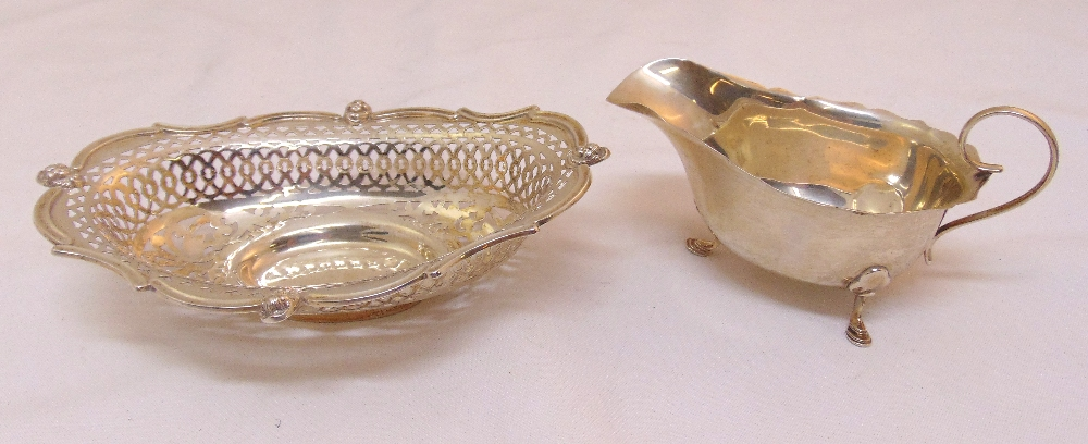 A hallmarked silver shaped oval pierced bonbon dish on oval base, Sheffield 1902 and a Mappin and